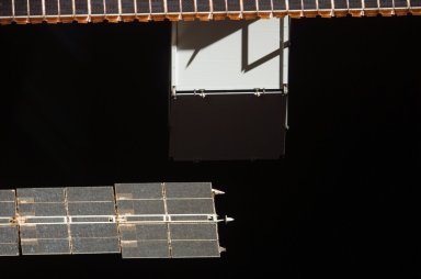 View of Solar Arrays taken from the orbiter after undocking from the ISS during STS-121