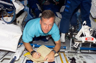 Lindsey writes in the ISS Ships Log during STS-121 / Expedition 13 joint operations