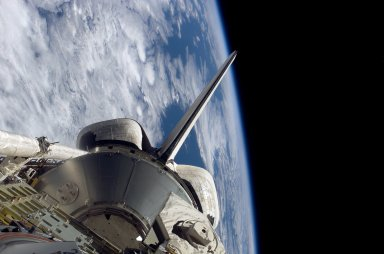 The orbiter PLB and Earth limb during STS-121