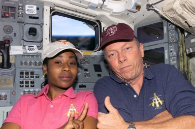 Fossum and Wilson pose for a picture together on the AFD during STS-121