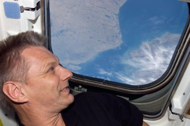 Sellers looks at the Earth from the orbiter AFD during STS-121 / Expedition 13 joint operations