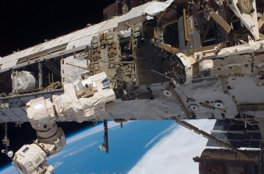 The SSRMS positions to grapple with the MBS during STS-121 / Expedition 13 joint operations