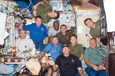 Crewmembers share a meal in the SM
