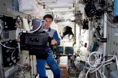 Krikalev with IMAX camera in Service module