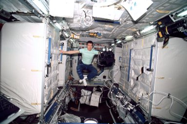 Krikalev in Lab module with IMAX camera