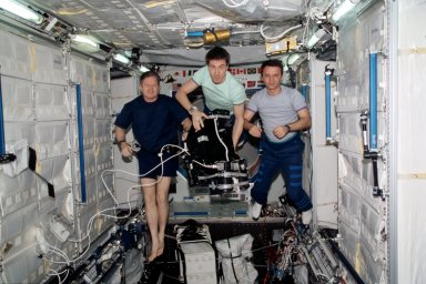 Expedition One crew in Lab module with IMAX camera