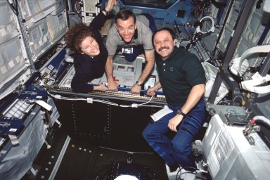 Expedition Two crew poses for photo in Destiny module