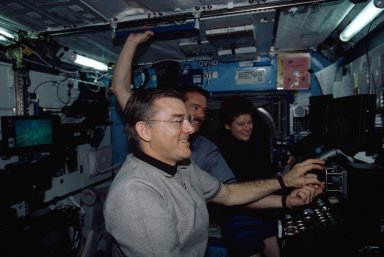 Expedition Two Voss at SSRMS controls with Hadfield and Helms in Destiny module