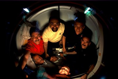 STS-100 crew in docking compartment after docking with ISS