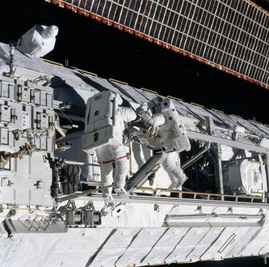 Herrington and Lopez-Alegria work to remove a stanchion on the P1 truss during STS-113 EVA OPS