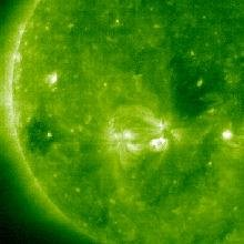 Over a period of four days (July 27 - 31, 2007) two active regions can be seen by SOHO communicating with each other magnetically. While the areas remained fairly stable, in that they did not generate any solar storms, the magnetic field lines of connection between them shift and sway most of the time. Like two magnets that sit near each other, the magnetic fields of the active regions share a dynamic interplay that is fun to watch. While we cannot actually see magnetic field lines, we can see charged particles in extreme ultraviolet light tracing the field lines above the surface of the Sun.