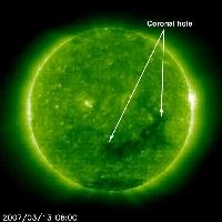 "For the past few days, the Earth has been passing through a stream of solar wind that is flowing out of this coronal hole (seen here on March 12-14, 2007). Coronal holes appear as dark area of the corona when viewed in ultraviolet light (here) and in X-rays. Since coronal holes are 'open' magnetically, strong solar wind gusts can escape from them and carry solar particles out to our magnetosphere and beyond. Solar wind streams take several days to travel from the Sun to Earth, and the coronal holes in which they originate are more likely to affect Earth after they have rotated more than halfway around the visible hemisphere of the Sun, which is the case here. The magnetic field lines in a coronal hole open out into the solar wind rather than connecting to a nearby part of the Sun's surface. Coronal holes are responsible for the high-speed solar wind streams that sweep through the plane where the planets orbit -- and thus have a direct affect on ""space weather"" near the Earth. People living at the higher latitudes have reported seeing some fairly colorful auroral displays."