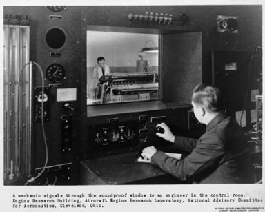 PUBLICITY ENGINE RESEARCH OPERATIONS SHOWING ENGINEERS OPERATING CONTROLS IN ENGINE CONTROL ROOM