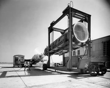PORTABLE CONTROL ROOM AND BLOWER AND AIRPLANE ON HANGAR APRON WITH PROPELLER IN MOTION/BLOWER AND AIRPLANE ON HANGAR APRON WITH PROPELLER IN MOTION