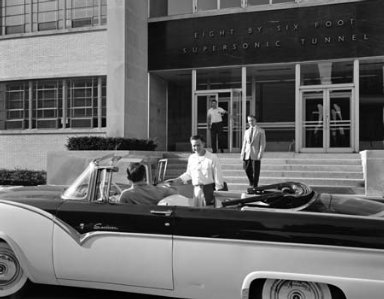 ENTRANCE TO 8X6 FOOT WIND TUNNEL BUILDING SHOWING ENGINEERS LEAVING FOR CLASSES AFTER BEING GRANTED LEAVE TO ATTEND ADVANCED COURSES AT UNIVERSITY AWAY FROM THE LEWIS FLIGHT PROPULSION LABORATORY LFPL
