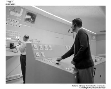 CONTROL ROOM IN NEW ROCKET LABORATORY OFFICE BUILDING TO SHOW GENERAL PRECISION LABORATORY GPL RUGGEDIZED CAMERA SYSTEM TELEVISION SCREEN AND PERSONNEL OPERATING ROCKET ENGINE