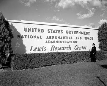 MAIN GATE AND NEW SIGN SHOWING NEW NATIONAL AERONAUTICS AND SPACE ADMINISTRATION NASA NAME