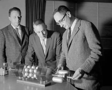 J W WEETON - D L MCDANELS - R W JECH NASA LEWIS RESEARCH CENTER ENGINEERS WITH MODEL OF A HYPOTHETICAL NUCLEAR SPACESHIP