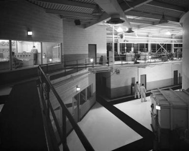REACTOR VIEW SHOWING CONTAINMENT VESSEL AND CONTROL ROOM WITH MEN WORKING ON THERMOCOLUM FOR QUADRANT B AT NASA PLUM BROOK STATION