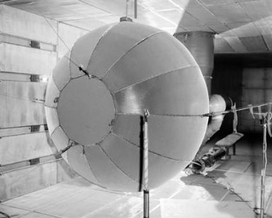 INLET TURBULENCE SCREEN AND HONEYCOMB ASSEMBLY MOUNTED 20 INCH FAN SIMULATOR IN THE 9X15 FOOT WIND TUNNEL