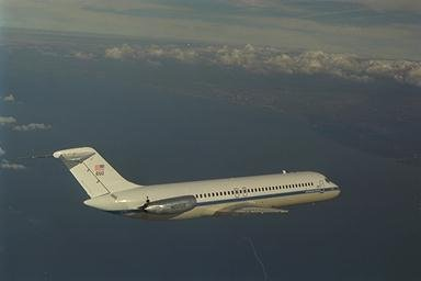 DC-9 AIRPLANE WITH CLEVELAND OHIO IN BACKGROUND