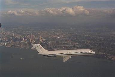DC-9 AIRPLANE FLYING OVER CLEVELAND OHIO SEPTEMBER 23 1994