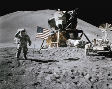 VARIOUS SPACE MISSIONS - ASTRONAUT SALUTING THE AMERICAN FLAG WITH LUNAR ROVER AND MODULE IN BACKGROUND