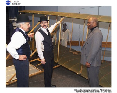 NASA GLENN CENTER DIRECTOR DONALD J CAMPBELL WITH REPLICA OF WRIGHT BROTHERS KITE