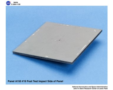 carbon/carbon fiber panels, panel A150 #19 post test isometric view of impact side