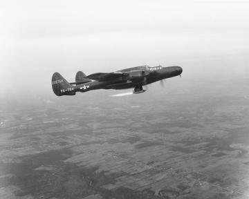 P-61 AIRPLANE IN FLIGHT TEST WITH RAM JET BURNING