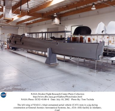 The left wing of NASA's Altair unmanned aerial vehicle (UAV) rests in a jig during construction at G