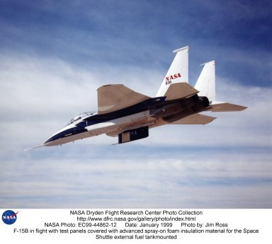 F-15B in flight with test panels covered with advanced spray-on foam insulation material for the Spa