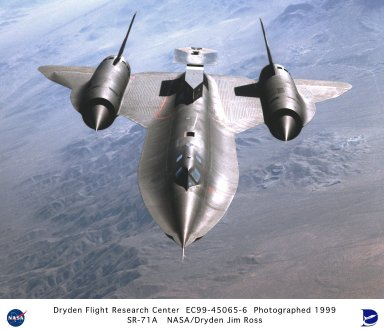 SR-71A in Flight with Test Fixture Mounted Atop the Aft Section of the Aircraft