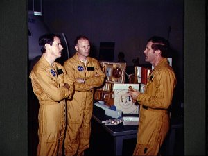 """Skylab 4 astronauts during an """"open house"""" press day in Skylab mock-up"""