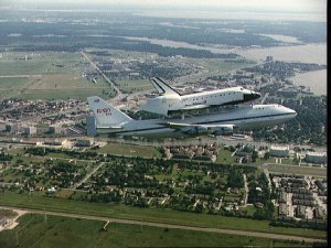 Air to air view of Endeavour, OV-105, atop SCA flies over JSC enroute to KSC