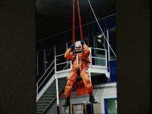 Astronaut Sidney Gutierrez suspended by parachute during bailout training