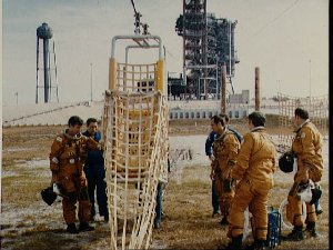 STS-1 crew and backups are briefed on KSC slide wire system by G.W.S. Abbey