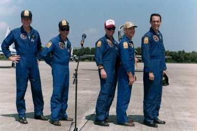 """STS-69 Crew members display """"Dog Crew"""" patches"""