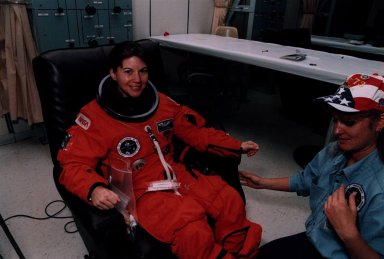 STS-73 Mission Specialist Catherine Coleman suits up
