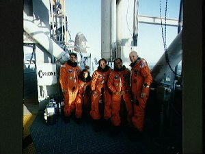 STS-33 crewmembers on KSC LC Pad 39B 195 ft level with OV-103 in background