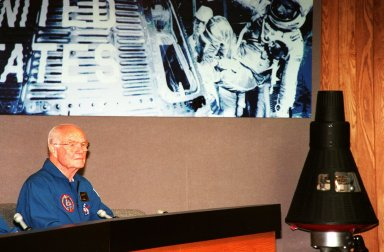 STS-95 Payload Specialist Glenn participates in a media briefing before returning to JSC