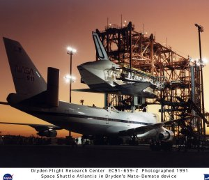 Shuttle in Mate-Demate Device being Loaded onto SCA-747 - Side View