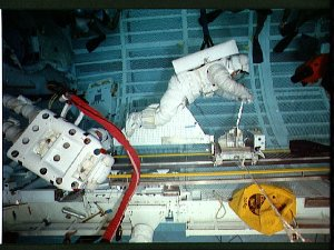 STS-37 crewmembers with CETA mechanical cart during simulation in JSC's WETF