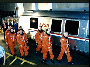 STS-35 crew leaves KSC O and C Bldg and boards van for transport to LC Pad 39A