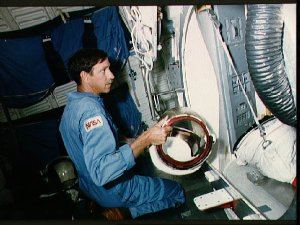 Astronaut Richard Covey working in the Crew Compartment Trainer