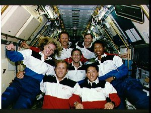 STS-47 crew poses for Official onboard (in space) portrait in SLJ module