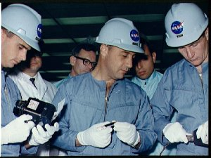 Prime crew of first Apollo manned flight inspect spacecraft equipment