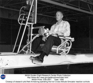 Closeup of research pilot Neil Armstrong operating the Iron Cross Attitude Simulator reaction contro