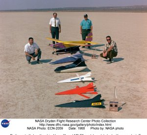 Radio controlled mothership, Hyper III, and M2-F2 models on lakebed with research staff
