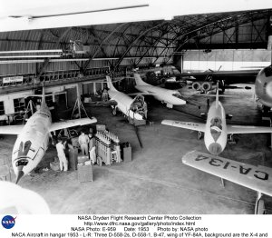 NACA Aircraft in hangar 1953 - L-R: Three D-558-2s, D-558-1, B-47, wing of YF-84A, background are th